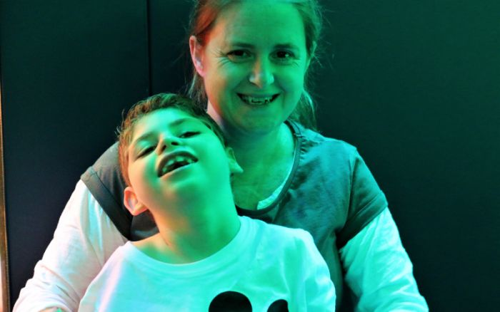 Archie and mum in sensory room